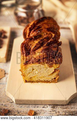 Sweet Homemade Almond Brioche Babka On A Wooden Cutting Board