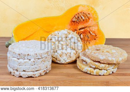Dry Round Puffed Multi-grain Crispbreads And Crispbreads With Pumpkin Addition Against The Half Of B