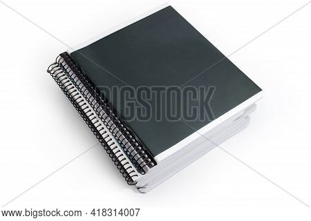 Stack Of The Different Closed School Exercise Books With Ordinary And Spiral Bindings On A White Bac