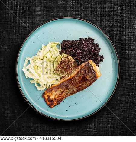 Grilled Salmon With Black Rice And Iceberg Lettuce, Top View, Flat Lay