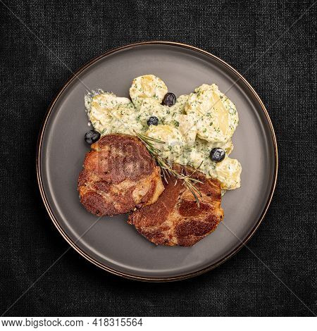 Juicy Grilled Pork Chop Served With Potato Salad, Top View, Flat Lay