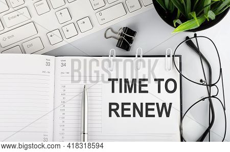 Text Time To Renew On White Stickers On Notebook With Keyboard And Glasses.