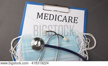 Folder With Paper Text Medicare , On A Table With A Stethoscope And Medical Masks, Medical