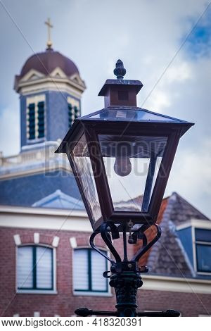 The Hartebrugkerk The Church In Leiden, Netherlands With The Lamppost In The Foreground