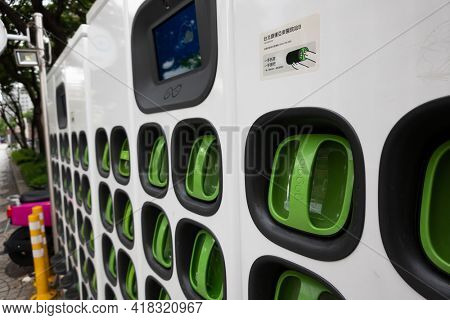 Taipei city, Taiwan - June 14th, 2020: charging station for battery packs of Taiwan-based Gogoro electronic motocycle at street in Taipei, Taiwan, Asia