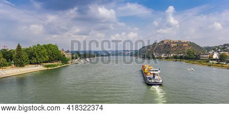 Panorama Of A Cargo Ship On The River Rhine Near Koblenz, Germany