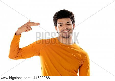 Cute african american man with afro hairstyle wearing a orange T-shirt isolated on a white background