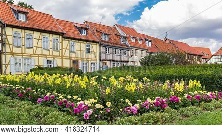 Colorful Flowers And Half Timbered Houses In Quedlinburg, Germany