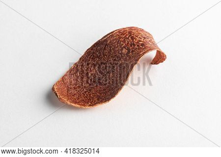 Piece Of Dried Fruit Peel On White Background