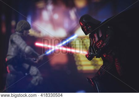 APRIL 25 2021: scene from Star Wars The Empire Strikes Back, Jedi Luke SKywalker battles Sith Lord Darth Vader with lightsabers - Hasbro action figures