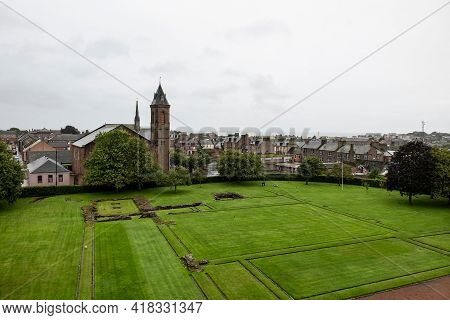 Courtyard Of The Arbroath Abbey In Scotland With Cityscape Of The Scottish Town