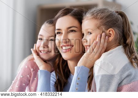 people, family and love concept - happy smiling mother with two daughters at home