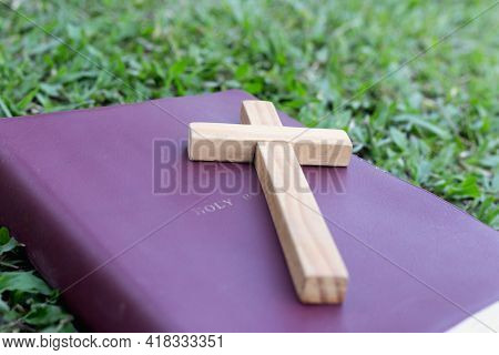 The Cross Is Placed On The Bible. Natural Background. Prayer Of Blessing From Jesus God. Have Faith