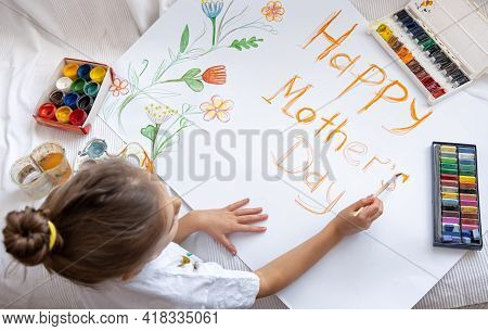 Little Girl Paints With Paints And Crayons Greeting Card For Mom On Mother's Day With The Inscriptio