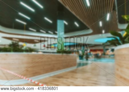 Young People Shopping Mall Blurred Background. Interior Of Retail Centre Store In Soft Focus. People