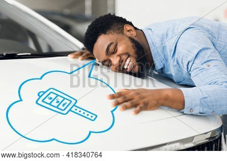Happy African American Man Hugging New Car, Dreaming About Buying Vehicle In Auto Dealership, Creati