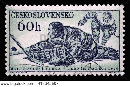 ZAGREB, CROATIA - SEPTEMBER 18, 2014: Stamp printed in Czechoslovakia shows a picture of a hockey players, with the inscription Championship ice hockey world, 1959, circa 1959