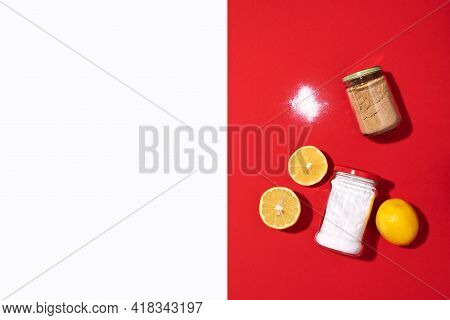 Eco-friendly Natural Cleaners. Baking Soda, Salt, Lemon And Mustard Powder On Red Background. Top Vi