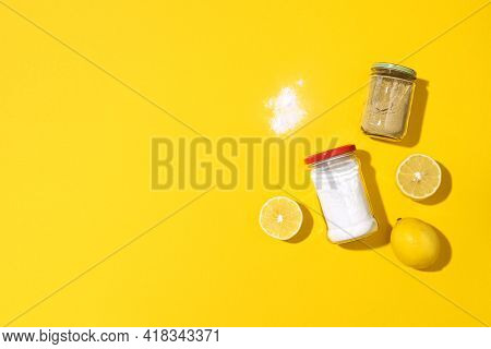 Eco-friendly Natural Cleaners. Baking Soda, Salt, Lemon And Mustard Powder On Yellow Background. Top