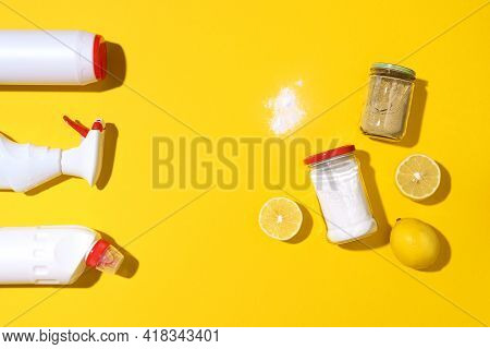 Baking Soda, Lemon And Mustard Powder Against Household Chemicals Products Over Yellow Background. T