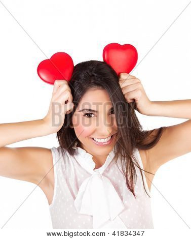 Photo of pretty brunette woman with two red heart toys, closeup portrait of cute female isolated on white background, Valentine day, cheerful facial expression, love and happiness concept