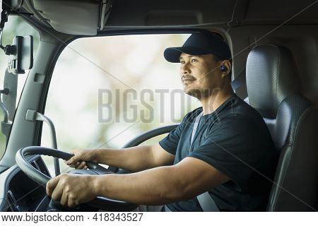 Professional Male Truck Driver Asian Driving Transport Vehicle And Fastening Seat Belt Safety. Men T
