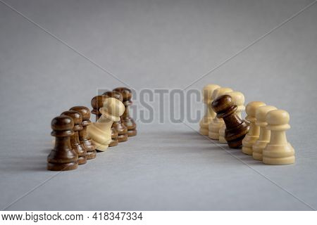 Chess Pieces. White Pawn Looks Out From Black Row, The Black One From White Row. Gray Isolated Textu