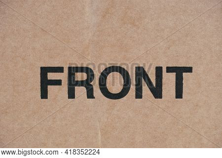 Word Front Printed On Cardboard. Close Up