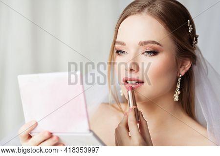 Bride Make Up. Bridal Wedding Makeup. Lips Make Up Application. Beauty Model Applying Lipstick Looki