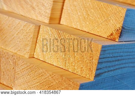 The Wooden Bars Are Stacked In A Stack. Sawing Drying And Marketing Of Wood. Industrial Background.
