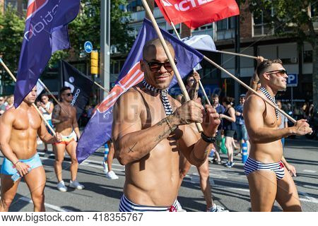 Barcelona - Spain. June 29, 2020: Group Of Young Athletic Guys In Only Short Briefs Of A Famous Span