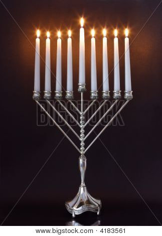Silver Hanukkah candles all candle lite on the traditional Hanukkah menorah poster