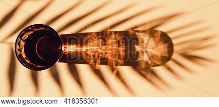 Glass Of Water On Sunlit Background With Shade. Summer Refreshment Concept. Minimal Style. Top View.