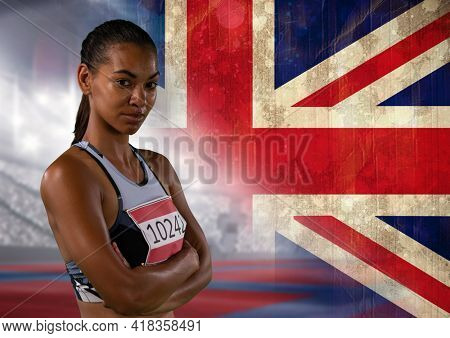 Portrait of african american female athlete against great britain flag and sports stadium. patriotism and sports concept