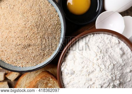 Fresh Breadcrumbs, Flour And Eggs On Table, Top View