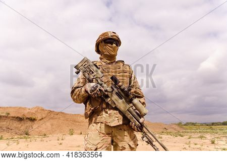 Equipped And Armed Special Forces Soldier With Sniper Rifle. Concept Of Military Anti-terrorism Oper