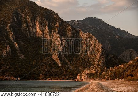 Incredible View Of Mountains With Green Trees Near The Coast Of The Sea Beach