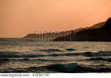 Magnificent Hill Landscape With View Of Mountains And Ocean And Sunny Sunset