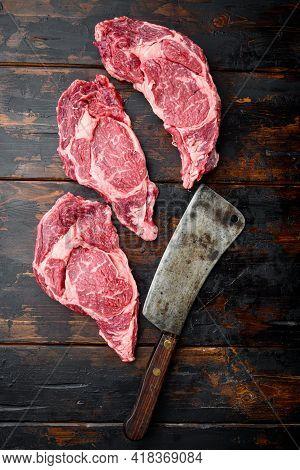 Raw Fresh Marbled Meat Steak Ribeye Black Angus Set, And Old Butcher Cleaver Knife, On Old Dark  Woo