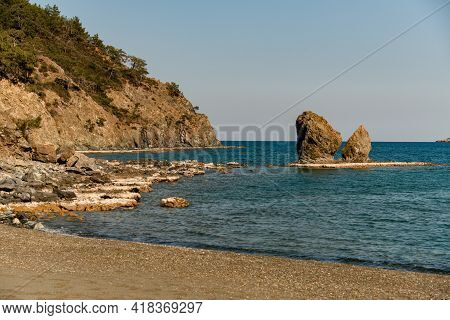 Magnificent View Of Hill And Large Rock In The Water Near Sea Coast