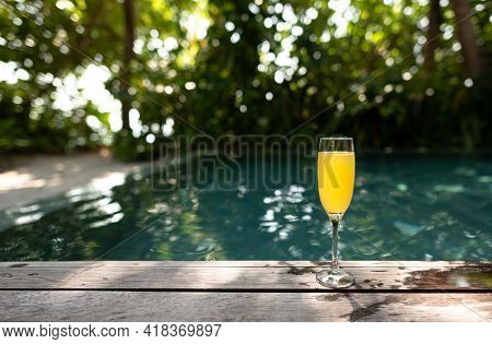 Tropical Cocktail On A Background Of Tropical Plant Leaves And Sun Shades. On A Background Of Tropic