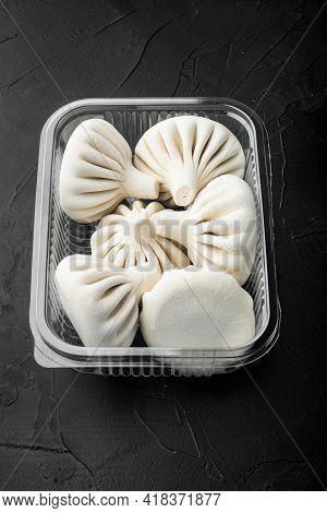 Manti Or Manty Dumplings, Popular Asian Dish Set, In Plastic Tray, On Black Stone Background