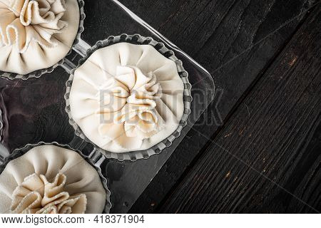 Manti, Turkish Traditional Ravioli Set, In Plastic Tray, On Black Wooden Table Background, Top View