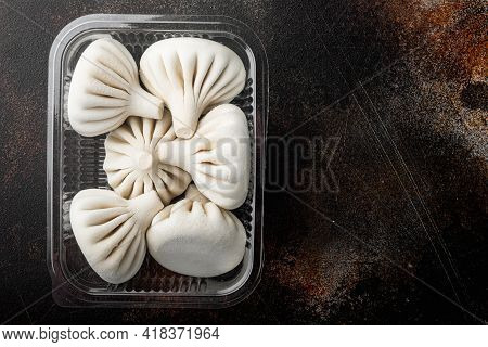 Stuffed Dumplings, Manti Of Dough And Minced  Set, In Plastic Tray, On Old Dark Rustic Background, T