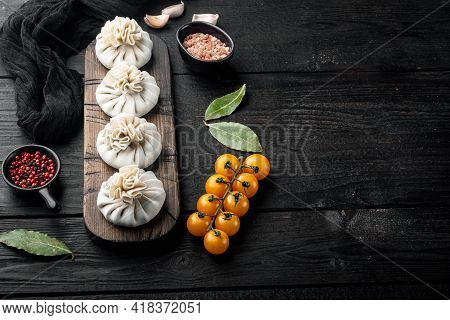 Manti, Turkish Traditional Ravioli Set, On Black Wooden Table Background, With Copy Space For Text