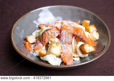 Fish Salad With Salmon And Breadcrumbs In A Plate.