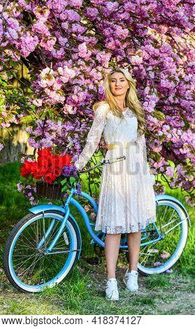 Enjoying Springtime. Natural Female Beauty. Woman In Garden. Young Fashionable Girl With Retro Bike