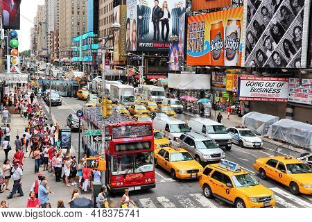 New York, Usa - July 3, 2013: People Visit 7th Avenue Near Times Square In New York. The Square At J