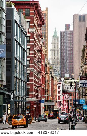 New York, Usa - July 1, 2013: People Visit Greene Street In Soho. New York City Is Visited By 56 Mil