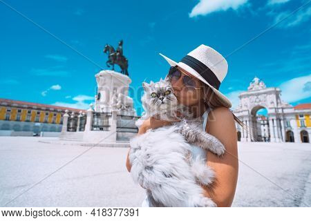 Woman Hugging And Kissing Her Lovely Persian Fluffy Cat. Cat Lover. Travel With Pet. Woman Tourist E